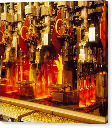 Production Line In Manufacture Of Glass Bottles Canvas Print by Victor De Schwanberg