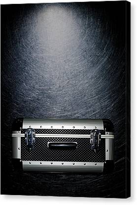 Protective Luggage Case On Stainless Steel. Canvas Print by Ballyscanlon