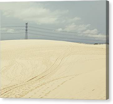 Pylon Atop Sand Dune Canvas Print by Photograph by Chris Round