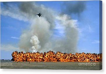 Pyrotechnics Explode While An F-15 Canvas Print by Stocktrek Images