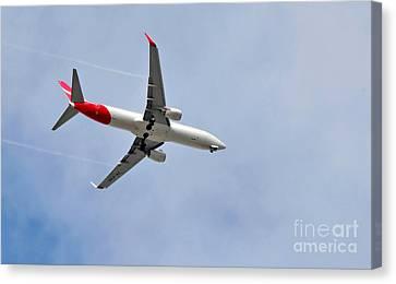 Qantas Heading Home Canvas Print by Kaye Menner
