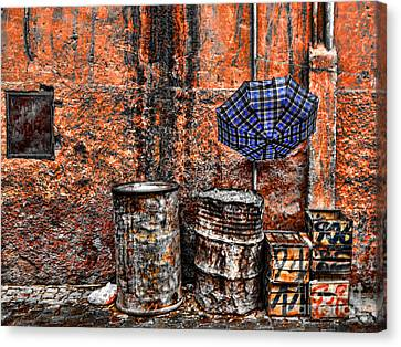 Rain In Marrakesh Canvas Print by Chuck Kuhn