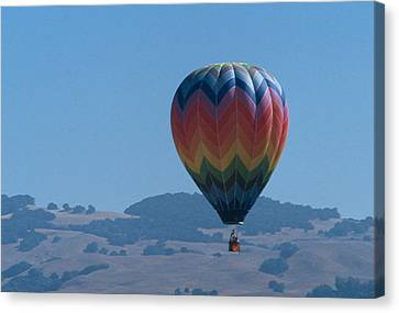Rainbow Balloon Over Hills Canvas Print