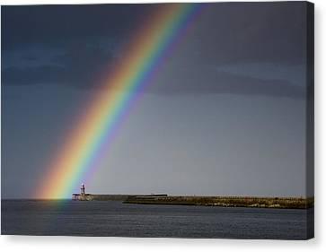 Rainbow Over Lighthouse Canvas Print by John Short