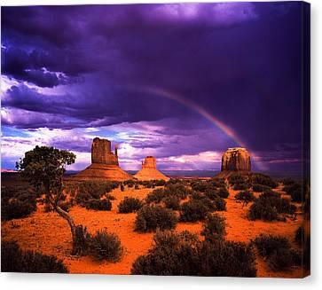 Rainbow Over Monument Valley Canvas Print by Daniel Chui