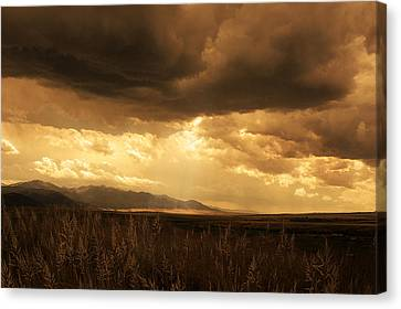 Reaching The Rockies Canvas Print by Jeff Burgess
