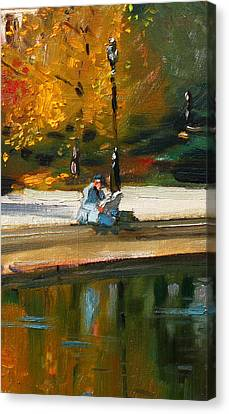 Reading The Paper Canvas Print by Ylli Haruni