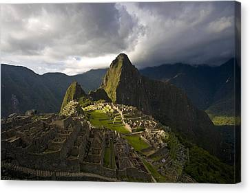 Reconstructed Stone Buildings On Machu Canvas Print by Michael Melford