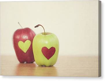 Red And Green Apple With Heart Shape Canvas Print by Maria Kallin