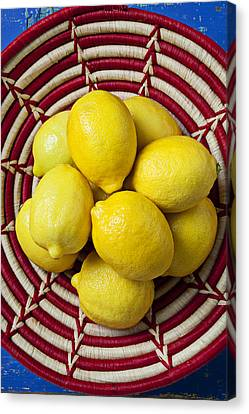 Red And White Basket Full Of Lemons Canvas Print by Garry Gay