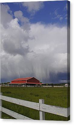 Red Barn And Stormy Sky Canvas Print by Mick Anderson