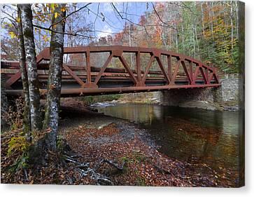 Red Bridge Canvas Print by Debra and Dave Vanderlaan