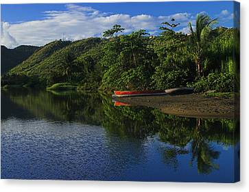 Red Canoe On Roseau River- St Lucia Canvas Print by Chester Williams