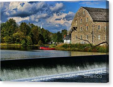 Red Canoes At The Boathouse Canvas Print by Paul Ward