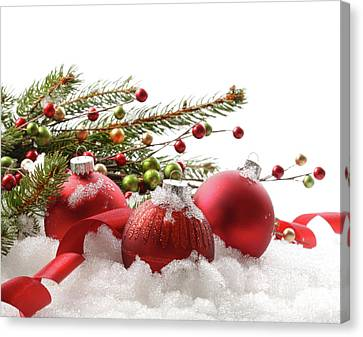 Red Christmas Balls In The Snow  Canvas Print by Sandra Cunningham