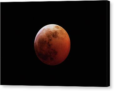 Red Eclipsed Moon Canvas Print by Photography By Escobar Studios