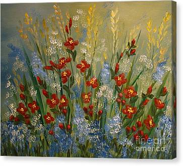 Red Flowers In The Garden Canvas Print by Leea Baltes