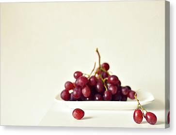 Red Grapes On White Plate Canvas Print by Photo by Ira Heuvelman-Dobrolyubova