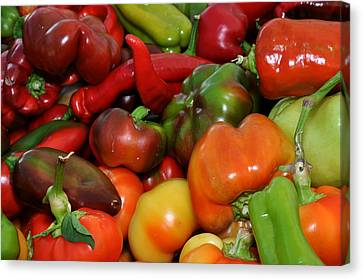 Canvas Print featuring the photograph Red Green Orange And Yellow Peppers by Diane Lent