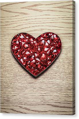 Red Hearts In A Heart Shape Canvas Print by Jonathan Kitchen