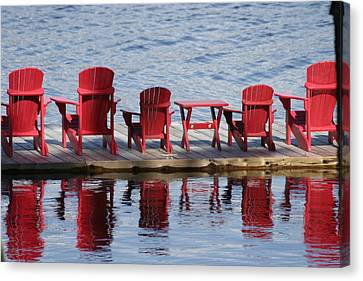 Red Muskoka Chairs Canvas Print by Carolyn Reinhart