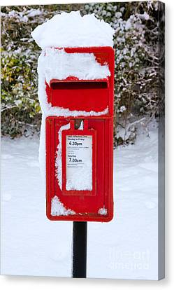 Red Postbox In The Snow Canvas Print by Richard Thomas