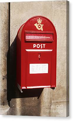 Red Postbox Mounted On Wall Canvas Print by Jeremy Woodhouse