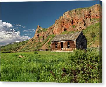 Red Rock Cabin Canvas Print by Leland D Howard