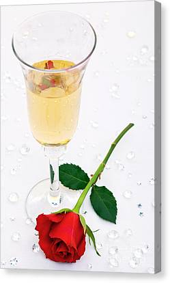 Red Rose And A Glass Of Champagne Canvas Print by Richard Thomas