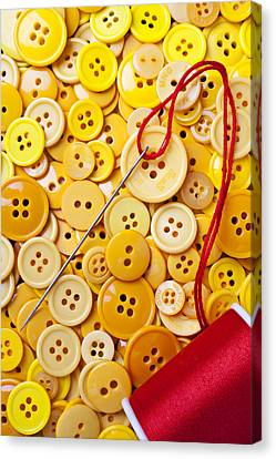 Red Thread And Yellow Buttons Canvas Print by Garry Gay