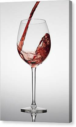 Red Wine Being Poured Into A Glass Canvas Print by Dual Dual