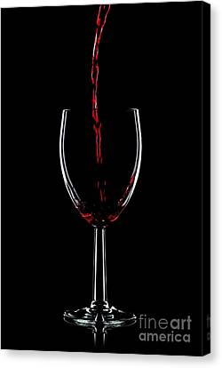 Red Wine Pouring Canvas Print by Richard Thomas