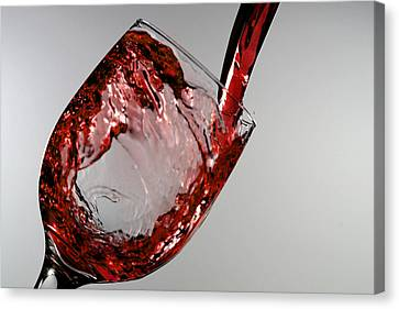 Red Wine Splashing From A Glass Cup Canvas Print by Paul Ge