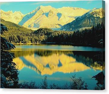 Reflecting On Auke Lake Canvas Print by Myrna Bradshaw