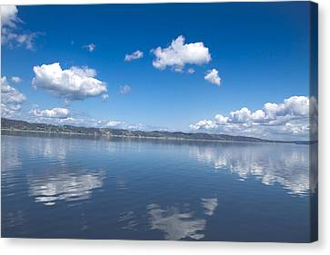 Reflecting Sky Canvas Print by Julie Smith