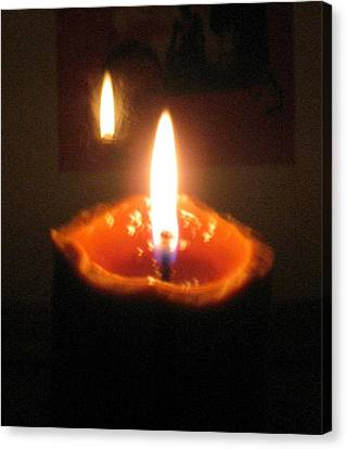 Reflection Of Burning Candle Canvas Print by Toni Roberts