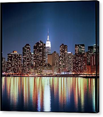Reflection Of Skyline Canvas Print by Shi Xuan Huang Photography