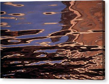 Reflection Patterns In The Waves Canvas Print by Paul Damien