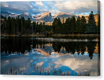 Reflections On A Lake Canvas Print by Anne Rodkin