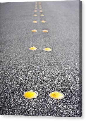 Reflective Roadway Divider Bumps Canvas Print by Thom Gourley/Flatbread Images, LLC