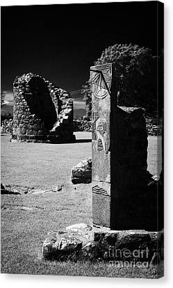 Remains Of The 6th Century Round Tower And Reconstructed Sundial Nendrum County Down Ireland Canvas Print by Joe Fox