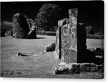 Remains Of The 6th Century Round Tower And Reconstructed Sundial On The Monastic Site At Nendrum  Canvas Print by Joe Fox