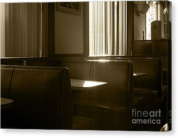 Restaurant Booth With Streaming Sunlight In Sepia Canvas Print