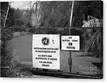 restricted area of the UN buffer zone in the green line dividing north and south cyprus in nicosia Canvas Print by Joe Fox