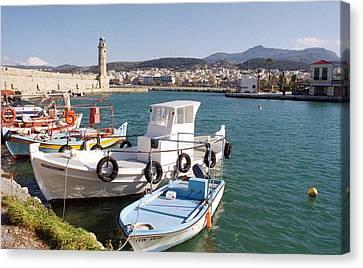 Rethymnon Harbour In Crete  Canvas Print by Paul Cowan