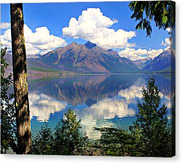 Rflection On Lake Mcdonald Canvas Print by Marty Koch