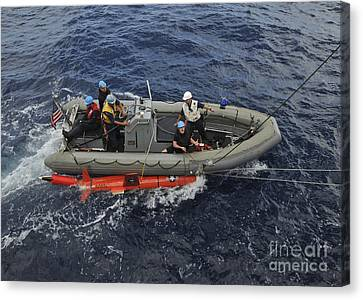 Rigid-hull Inflatable Boat Operators Canvas Print by Stocktrek Images