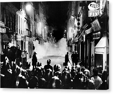 Riot Policemen At A Burning Barricade Canvas Print by Everett