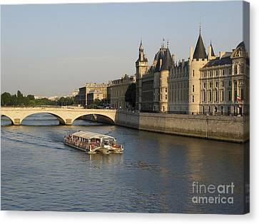 River Seine And Conciergerie. Paris Canvas Print by Bernard Jaubert