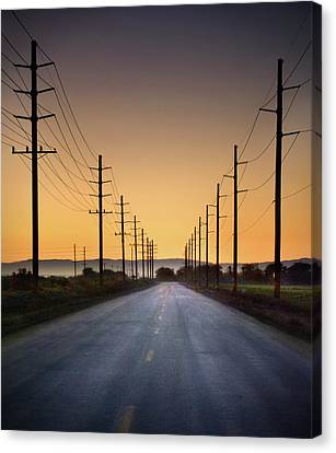 Road And Power Lines At Sunset Canvas Print by Www.jodymillerphoto.com